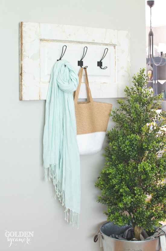 Just love this vintage coat rack made from an old door panel!