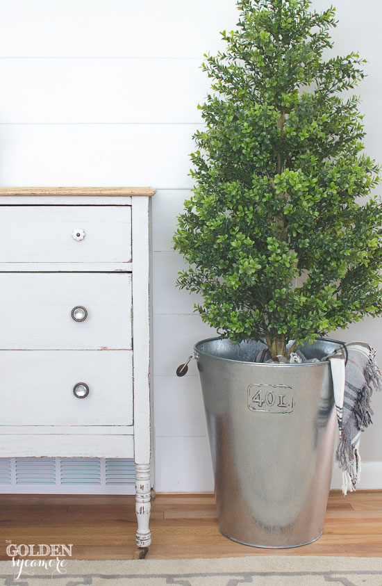 Light gray dresser with natural wood top