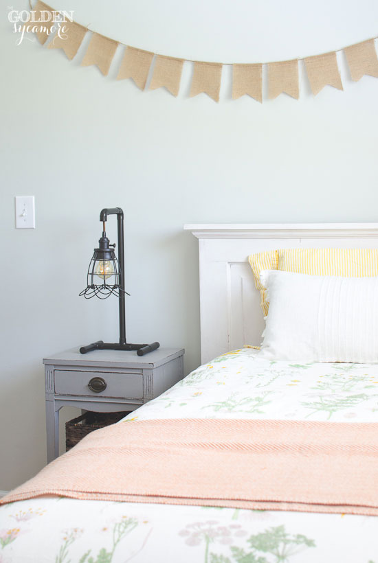 DIY repurposed vintage door into twin sized headboard