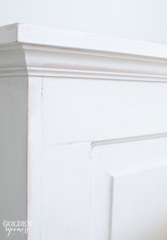 DIY repurposed vintage door into twin sized headboard