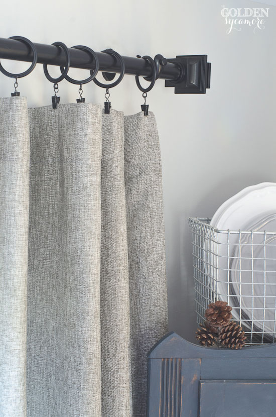 Gorgeous grey tweed curtains and black curtain rod from Prospect + Vine
