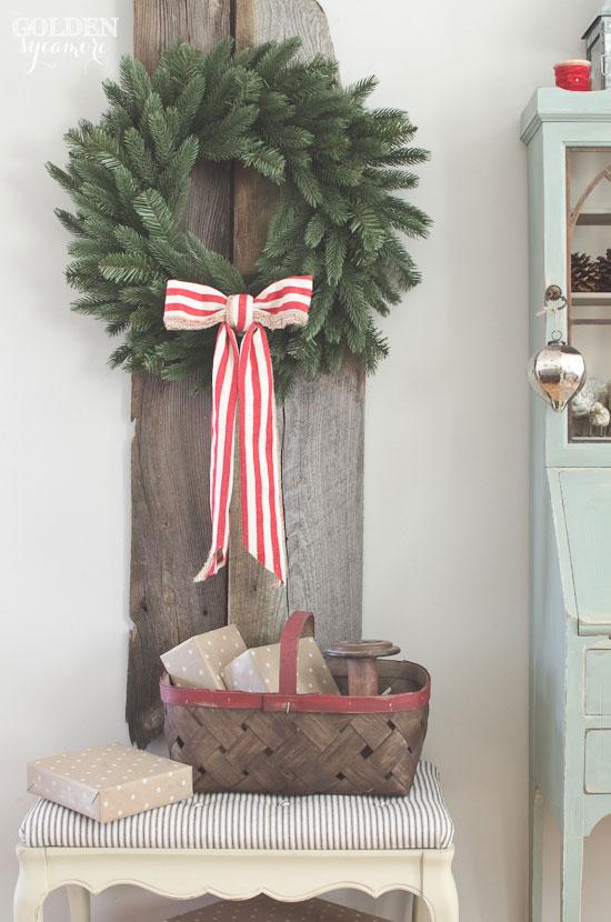 Beautiful big wreath on rustic barn wood