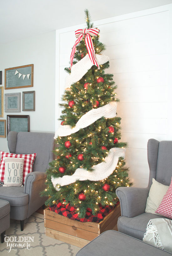 Cozy red and white Christmas tree with tree stand box