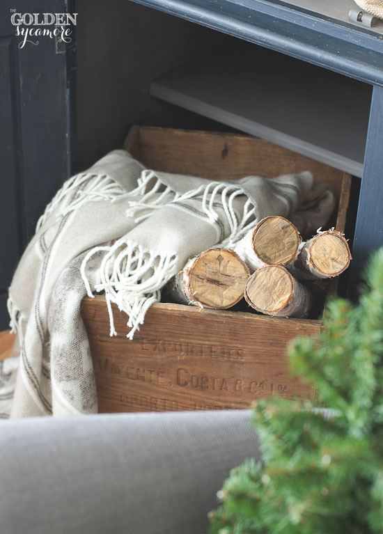 Birch wood & blanket in wooden crate