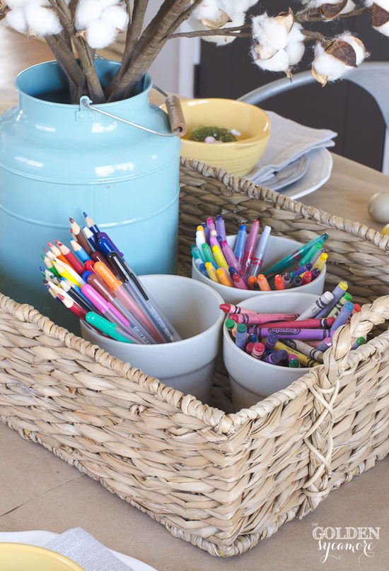 Functional spring centerpiece for kids with crayons, markers, and kraft paper table cloth