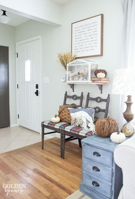 Neutral fall entryway with plaid chairs