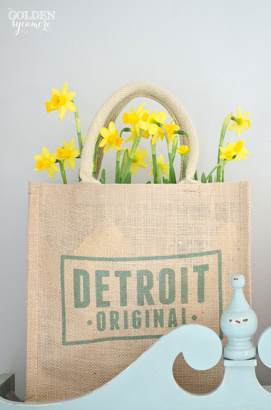 pretty yellow daffodils in burlap sack