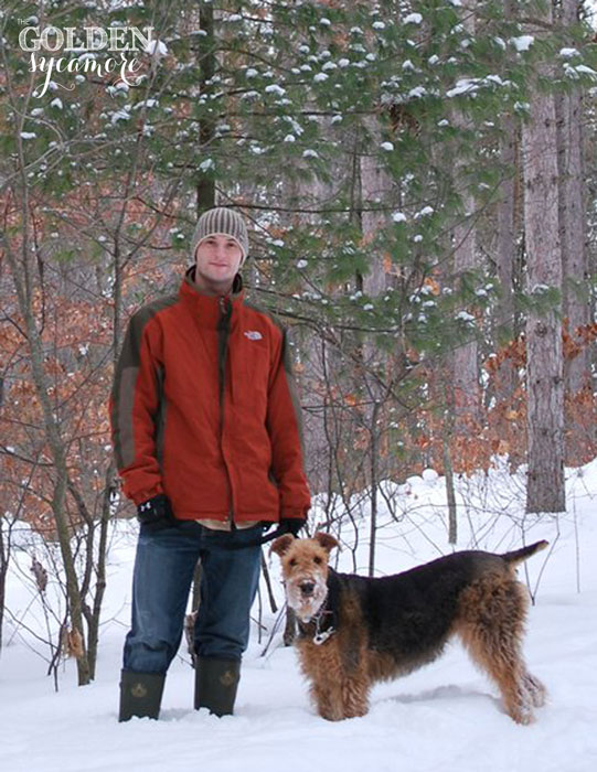Bailey Airedale and Travis in winter woods